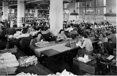 An interior view across the factory floor, showing women at work at the Pelaco factory, 1950s