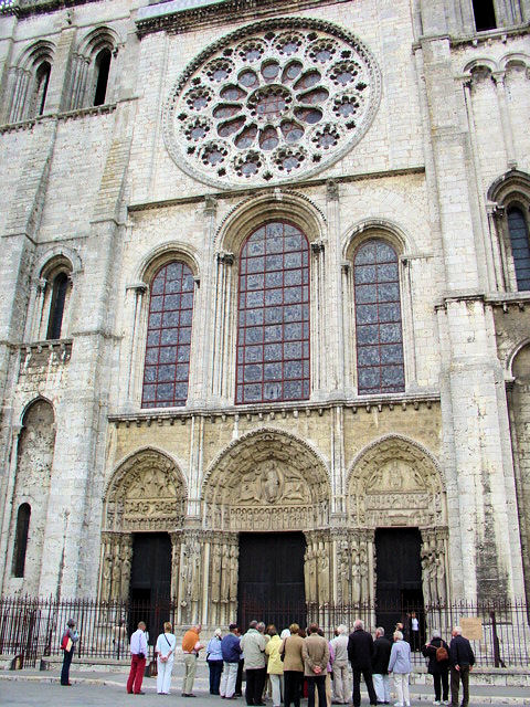 The Royal Portal of Chartres Cathedral in France. Above the doors and Main Gallery windows, you can see Abbot Suger's Rose window introduced at Saint-Denis in Paris.