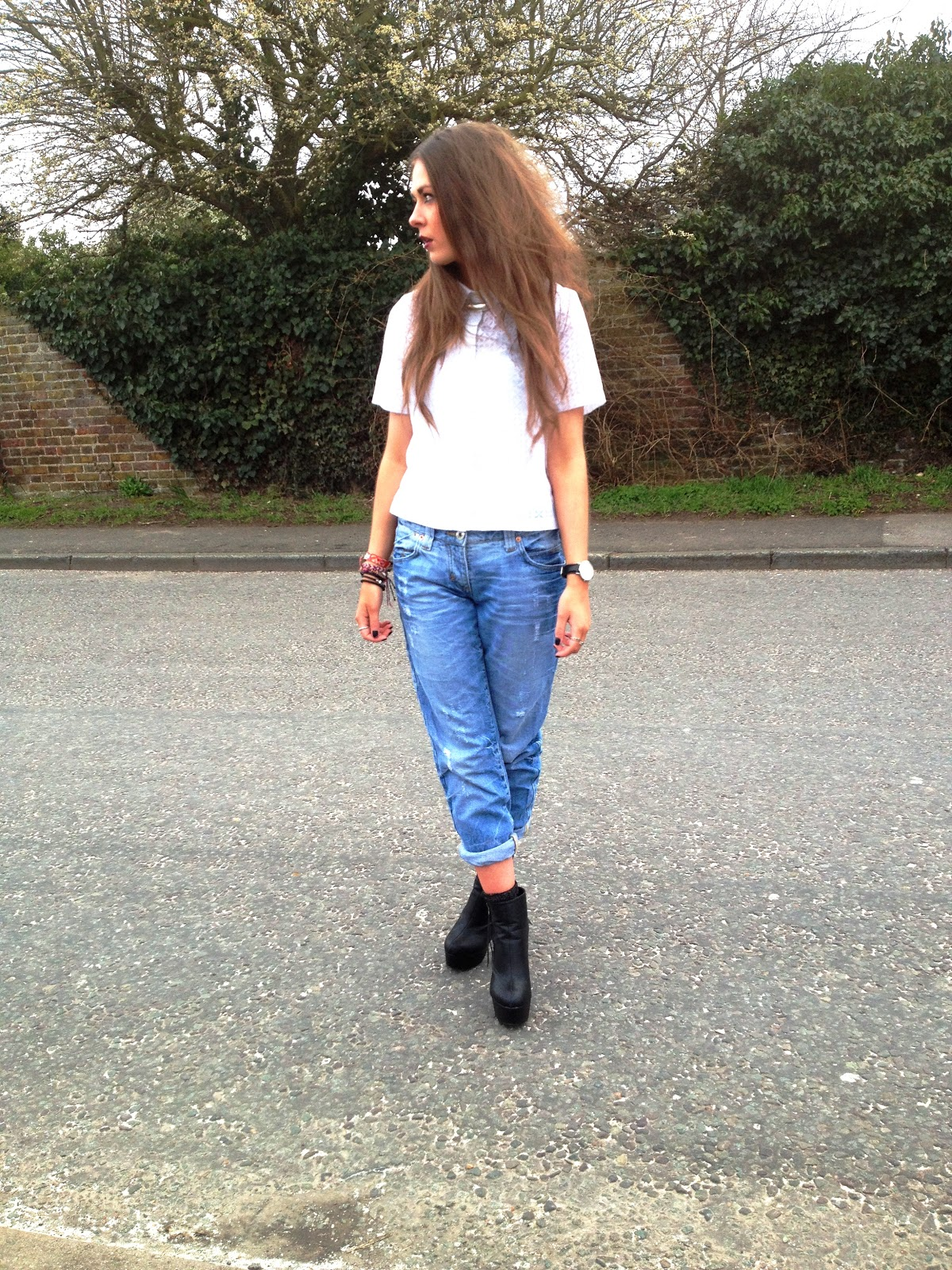 White shirt with denim jeans and black boot heels