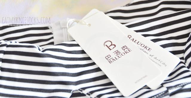 Details on Dresslink's striped zip-back cutout-waist V-neck accented skater dress.