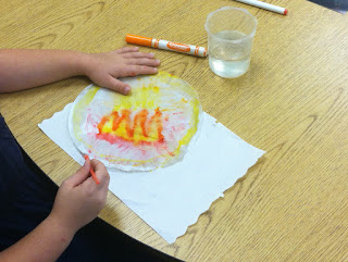 painting on fire designs on coffee filters (Brick by Brick)