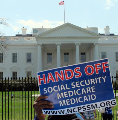 Protestor opposes cuts to entitlements outside White House