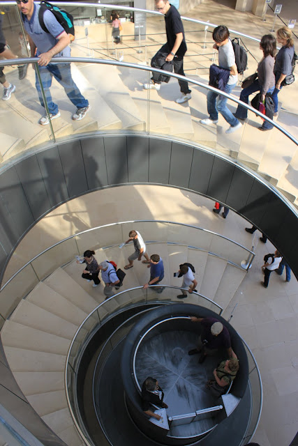Convertible elevator moves around the spiral stair in Lourve Museum in Paris, France