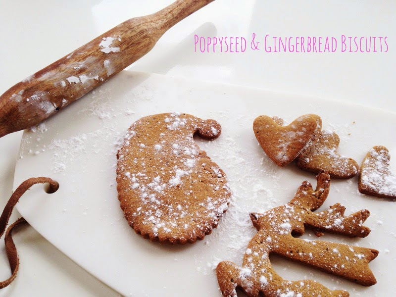 Poppyseed and gingerbread festive biscuits on a marble chopping board