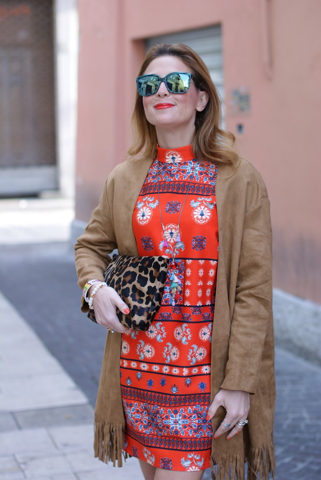 Suedette fringed coat from Yoins and ponyhair Cesare Paciotti clutch on Fashion and Cookies fashion blog, fashion blogger style