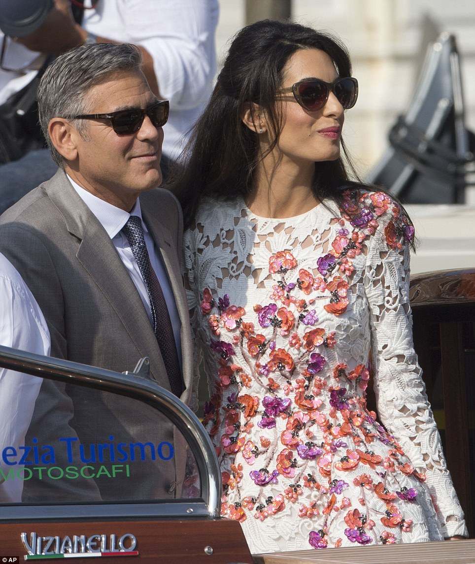 Amal Alamuddin makes first appearance as George Clooney's wife in Venice in a Giambattista Valli dress