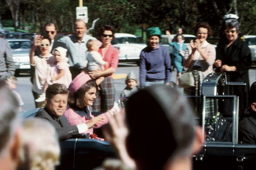 This H Warner King shot shows JFK and Jackie in the limo