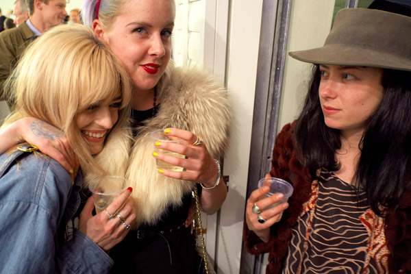 Three young art lovers, two wearing Fur, yellow nail polish, red lips; at the opening of Bill Henson '2012' Roslyn Oxley 9 gallery.