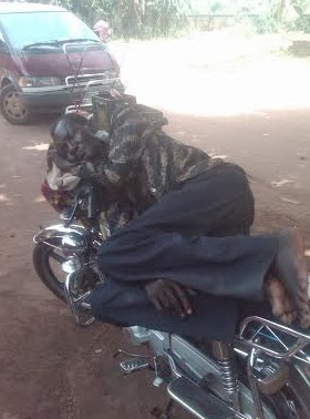 okada rider sleeping on bike