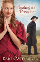 cover of Stealing the Preacher by Karen Witemeyer shows a woman in a red dress with her hands folded in prayer but her eyes are open and mischievous, a parson is standing a ways behind her and his hands are tied behind his back