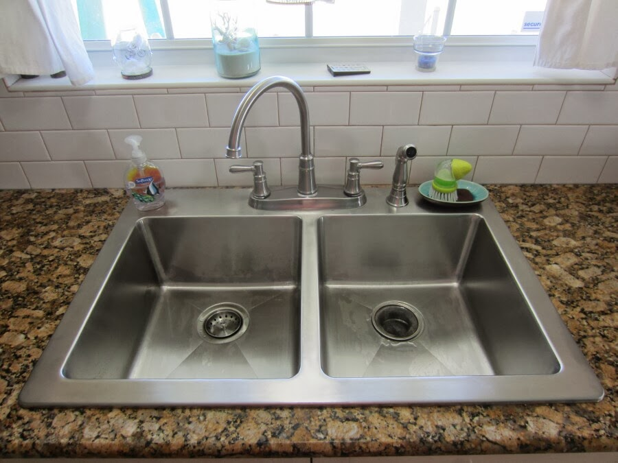 finally the sink was sized new caulk was applied to the counter top and the water problem addressed it was time to put the new sink in. beautiful ideas. Home Design Ideas
