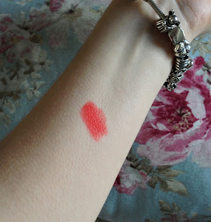 Retro orange lipstick swatch