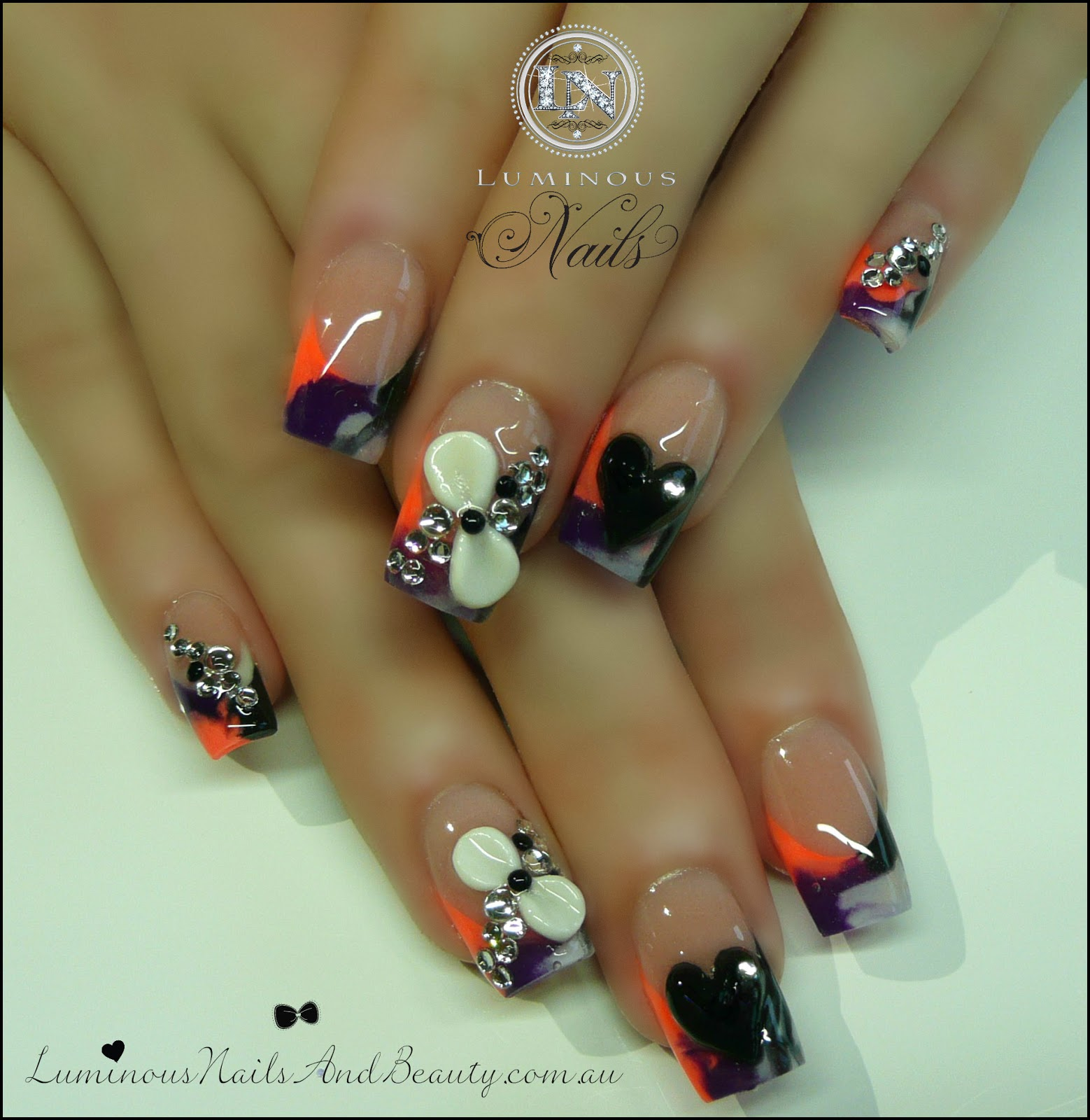 Black Acrylic Nail Designs with Bows