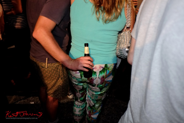 Print shorts and pants, green singlet from behind, Art Month Sydney art party Darlinghurst Sydney 2013
