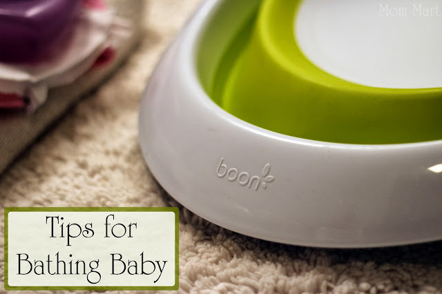 Tips for how to give baby a bath featuring Boon Inc. Naked 2-position collapsible baby bathtub