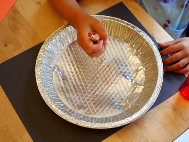 Easy Preschool space science- trace your pie pan