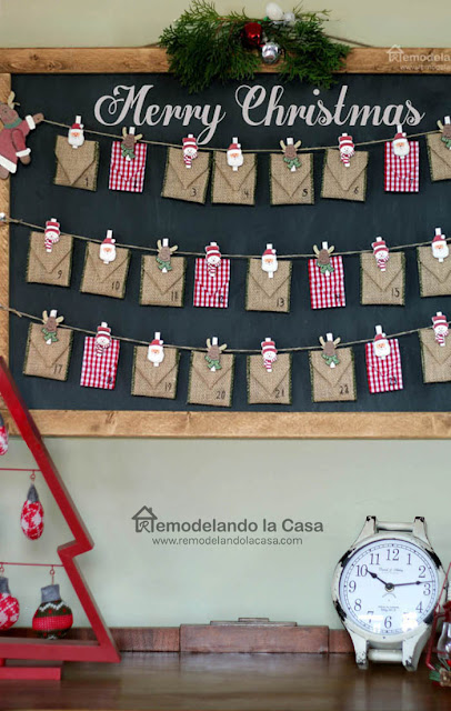 Burlap ribbon and checks envelopes on chalkboard