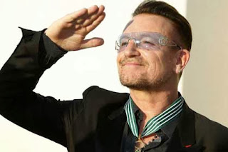 Bono received a medal in Paris. Source: independent.co.uk