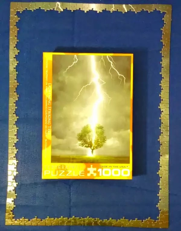 Jigsaw puzzle of a lightning bolt striking a tree