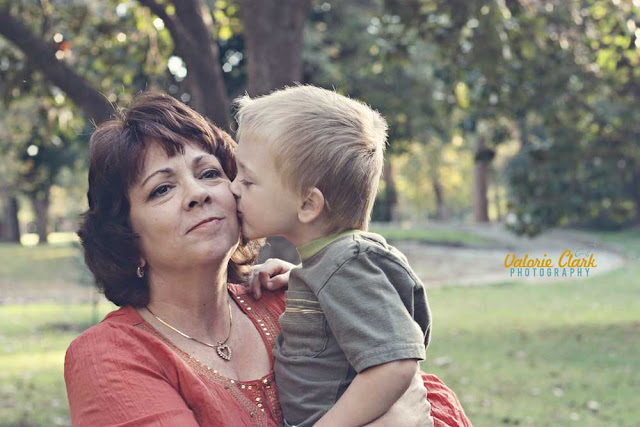 a grandson kissing his grandma