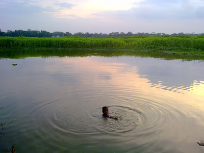 A child swimmer on river