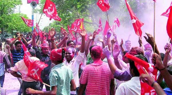 Left supporters celebrate in Siliguri