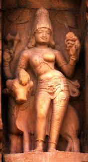 Ardhanarisvara, or Shiva and his shakti or female nature combined in one image. He-she is seen riding the bull Nandi. The seductive one-breasted torso is surmounted by the high-domed head which represents the lingam. The essential nature of Shiva is seen in the reconciliation of opposites. From the Elephanta caves.