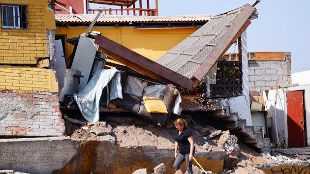 dos mil 500 viviendas resultaron destruidas en la norteña localidad de Alto Hospicio por el sismo de 8.3 grados