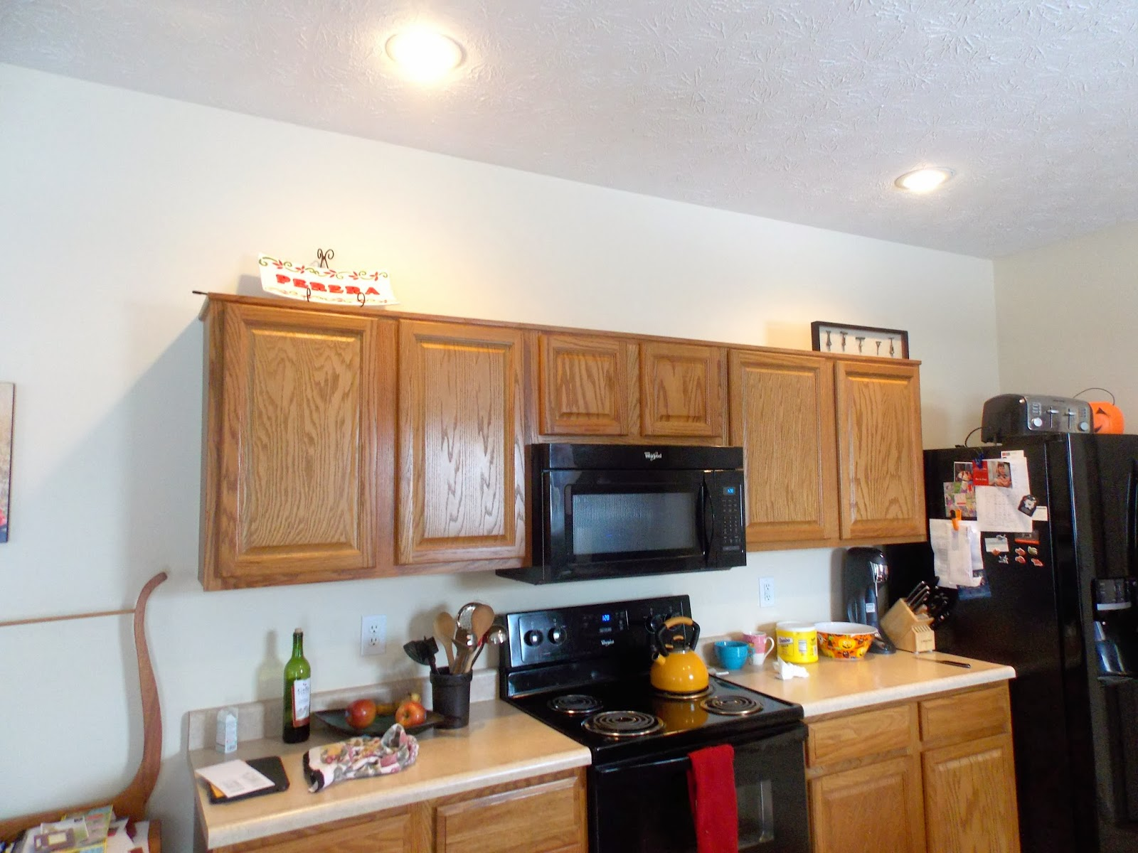Yes, we painted the cabinets white! What a difference this makes!!