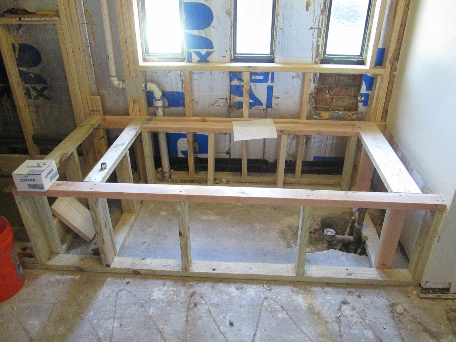 the rough framing for the new drop in tub also created a shower bench a beautiful new picture window took the place of these small windows - Drop In Tub Framing