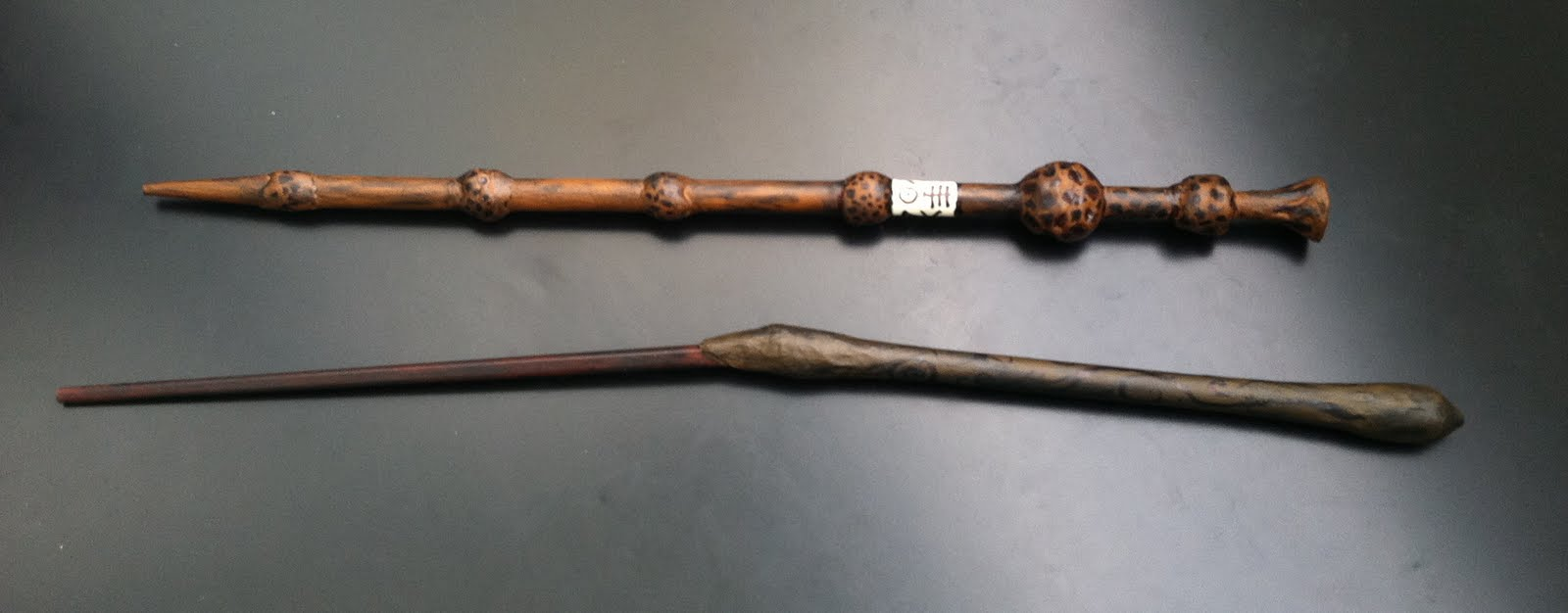 Cation designs pretending to be ollivander for Elder wand made of