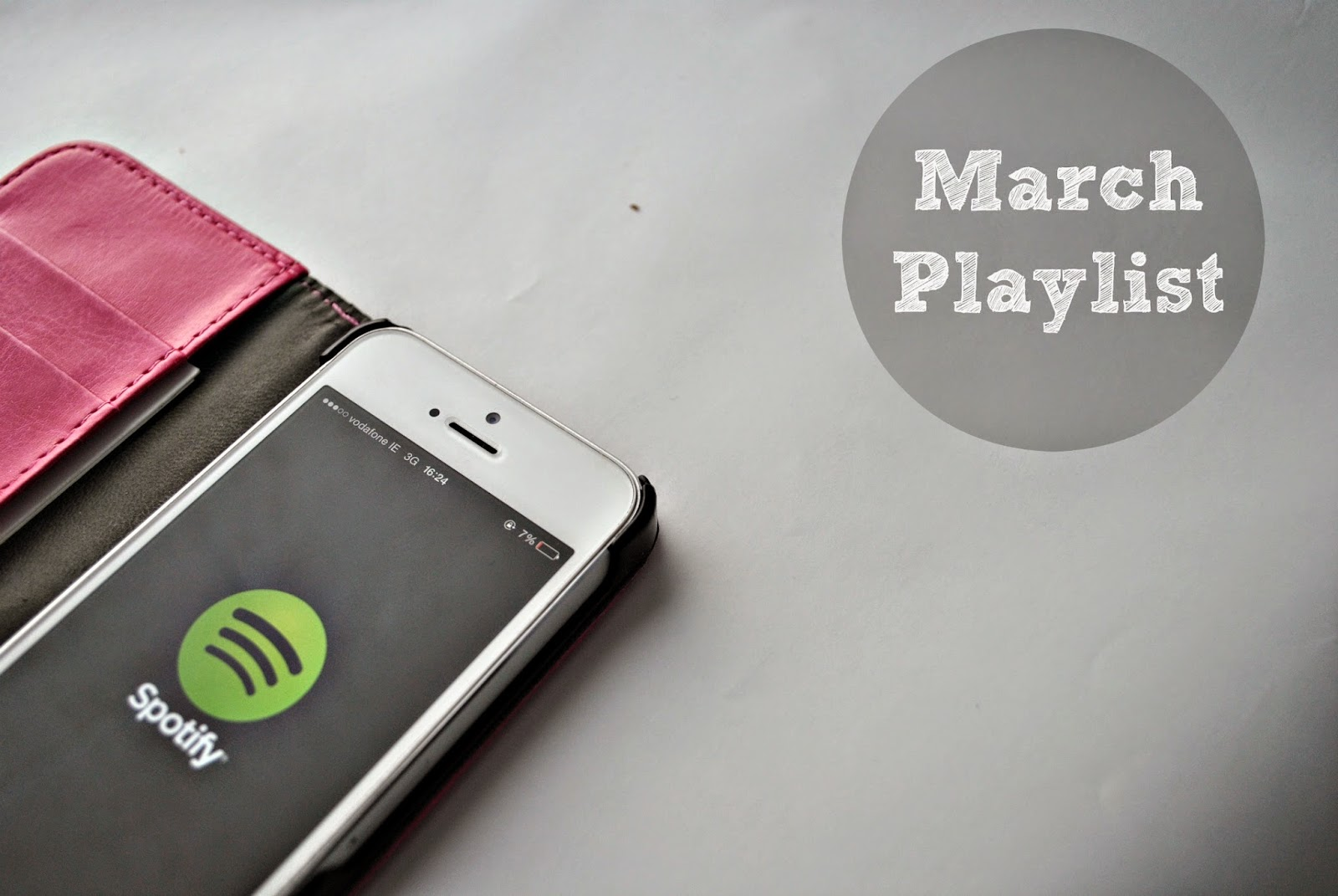 An iPhone with Spotify and a playlist