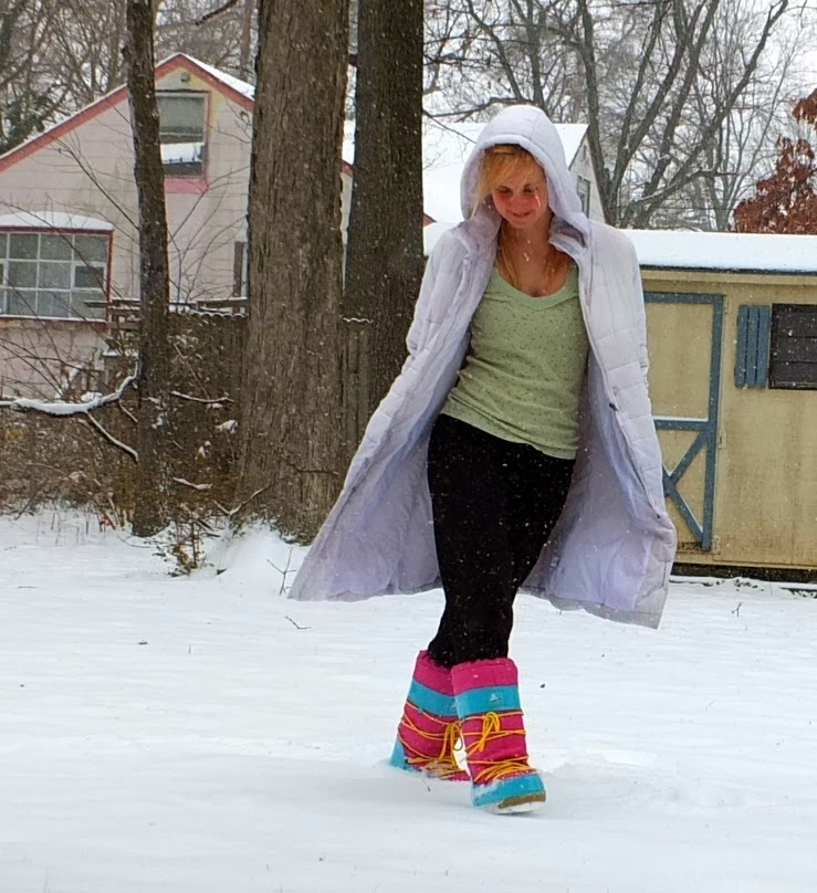 Valerie wearing her Big Foot Rubber Duck boots in a white coat in the snow.