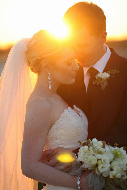warm romantic autumn sunset wedding pose