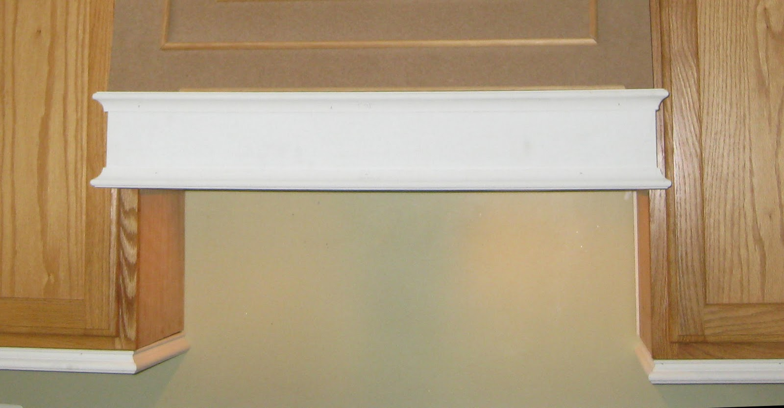 how to add trim to bottom of kitchen cabinets
