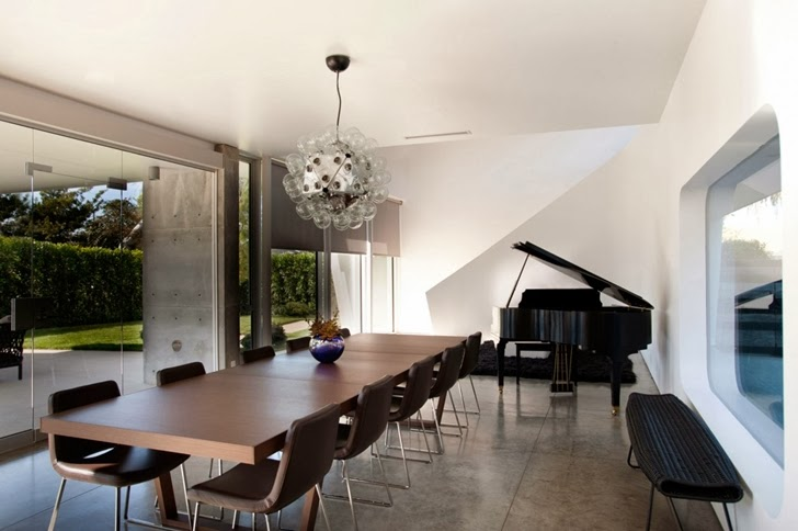 Dining room and piano in the Luxury modern family home in Venice, California