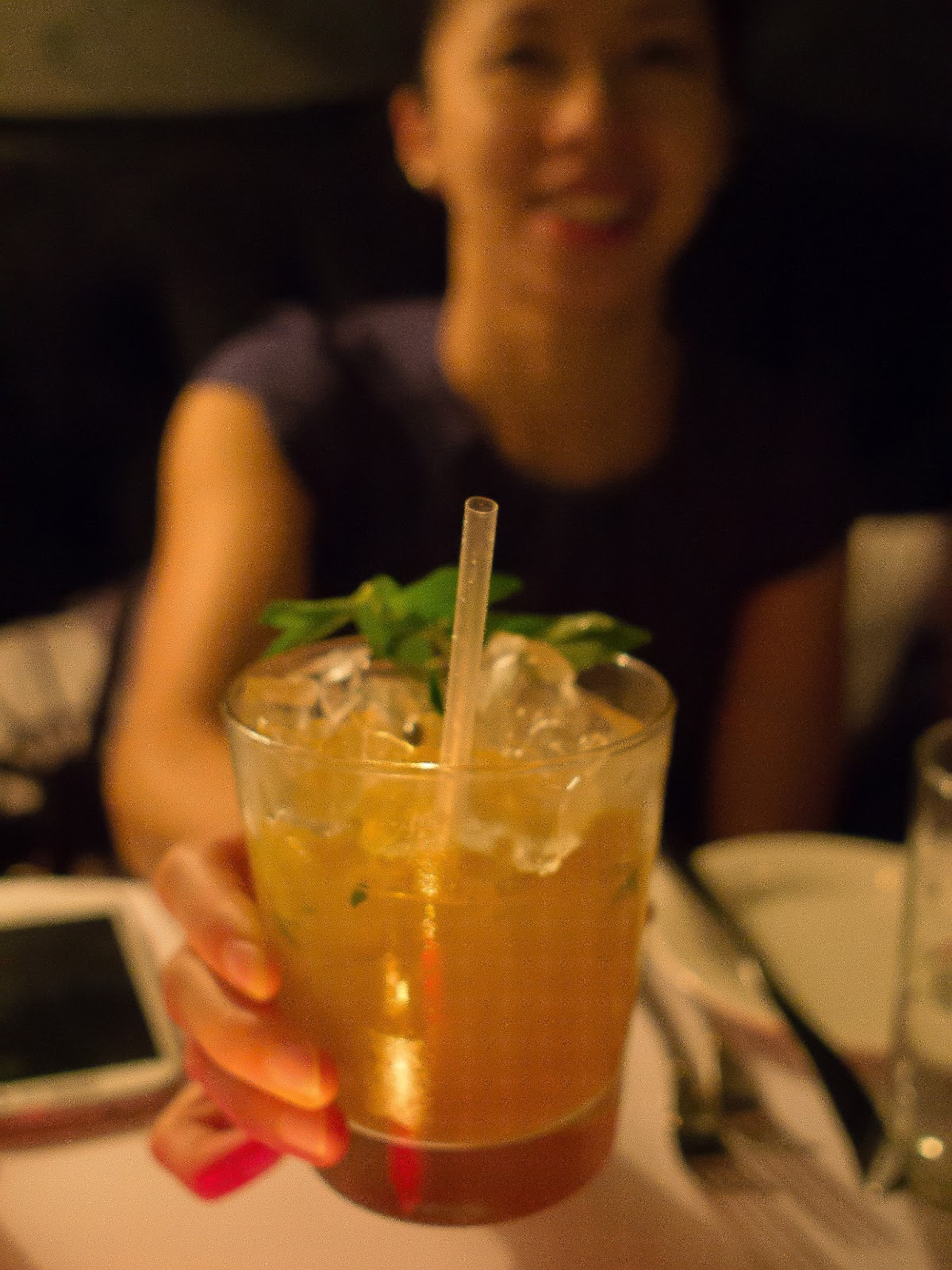 with her passionfruit and mint cocktail