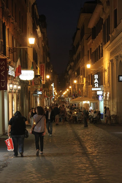 The nightlife in the city of Rome which is occupied by tourists and locals in cafes and restaurants in Rome, Italy