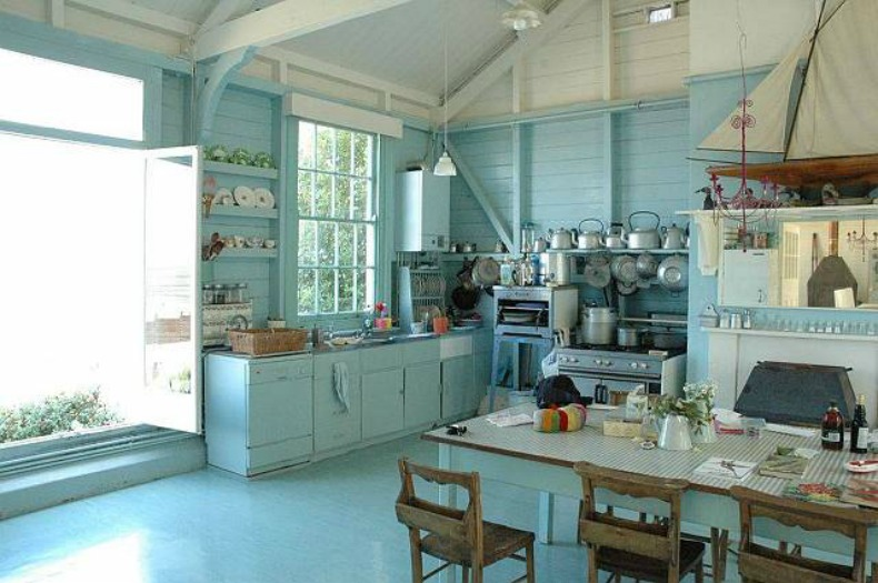 Light aqua blue on blue coastal cottage kitchen with open shelves and