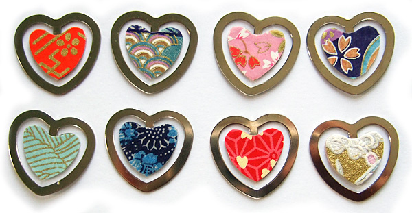 A selection of eight handmade heart-shaped bookmarks