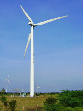 old traditional windmills compared with modern wind turbines