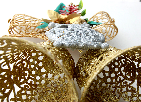 gold ribbon, gold bells and silver harp upclose