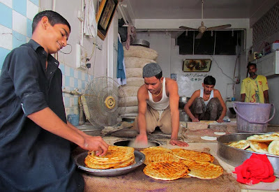 Men preparing special breads locally known as Taftan which are on demand due to Muharramul Haram majalis in Sukkur