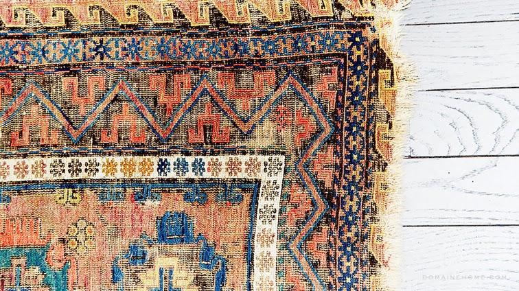 Vintage Turkish rug, white hardwood floor, home decor detail