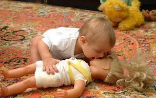 kid kisses his doll