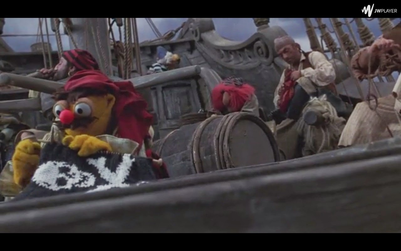 Scene from Muppet treasure island has one of the muppets knitting a pirate flag: the skull and crossbones