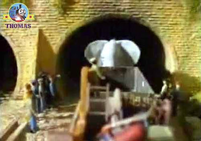 Henry train engine cargo truck wagon and a large cross gray elephant came out old stone tunnel exit