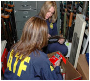 ATF Agents process guns.
