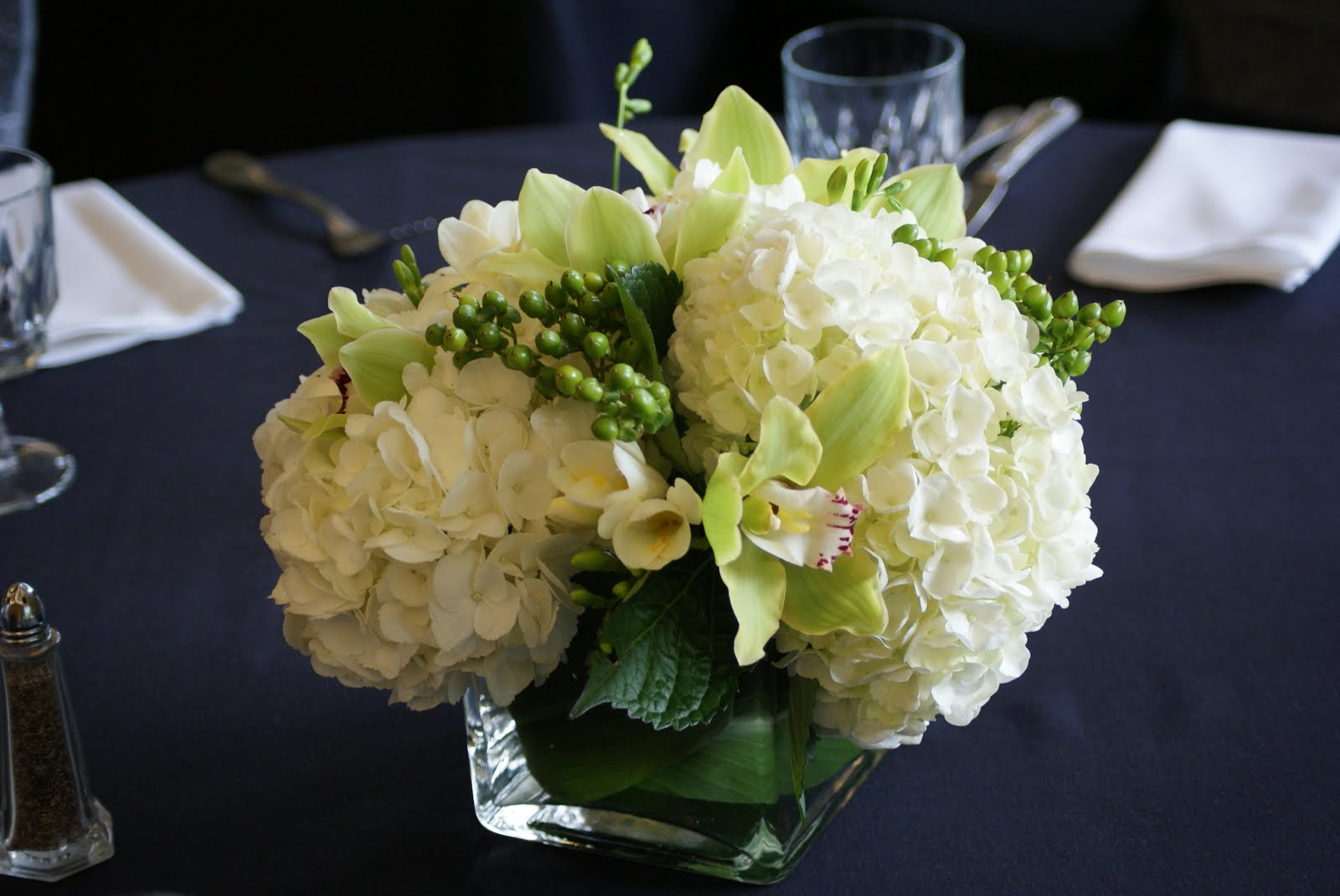 Low centerpiece with white hydrangea green cymbidium