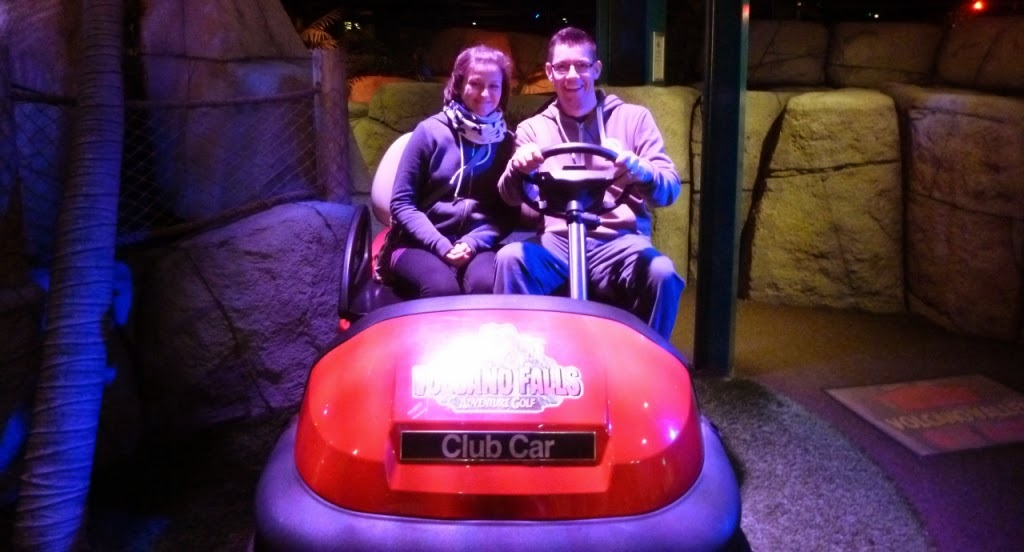 Minigolfers Emily and Richard Gottfried at Volcano Falls Adventure Golf at Xscape in Castleford, Yorkshire